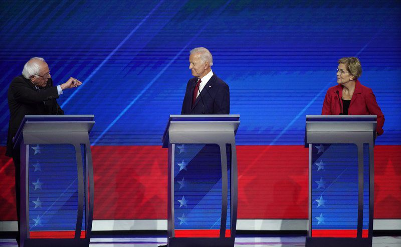 Fiery exchanges over health care costs at Democratic debate