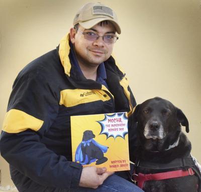 Newbury veteran and service dog Mocha publish their book