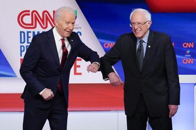 Sanders backs Biden in fight against Trump