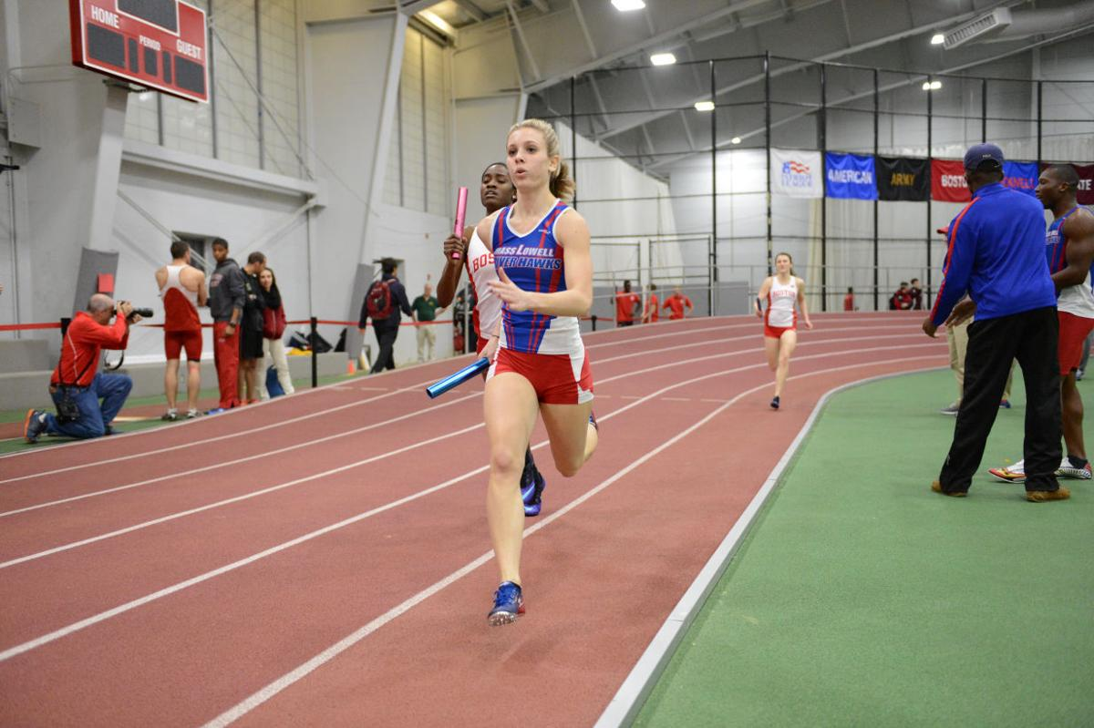 Taelour murphy of salisbury competes in a relay for the umass lowell indoor track team