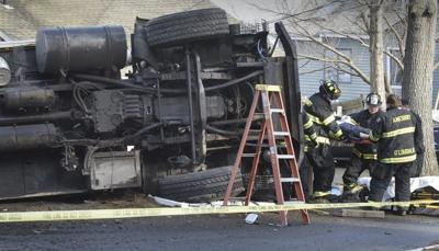 Trash truck flips in Amesbury, injuring driver