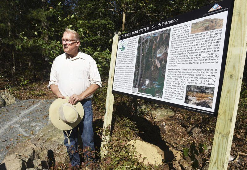 Trail system grows with parking lot, improved paths
