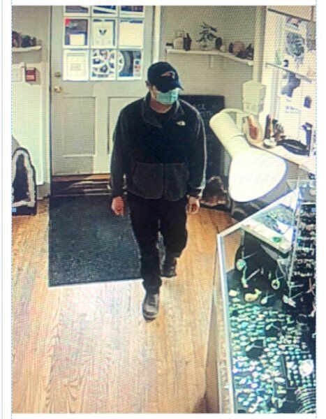 Police seek man who robbed downtown business