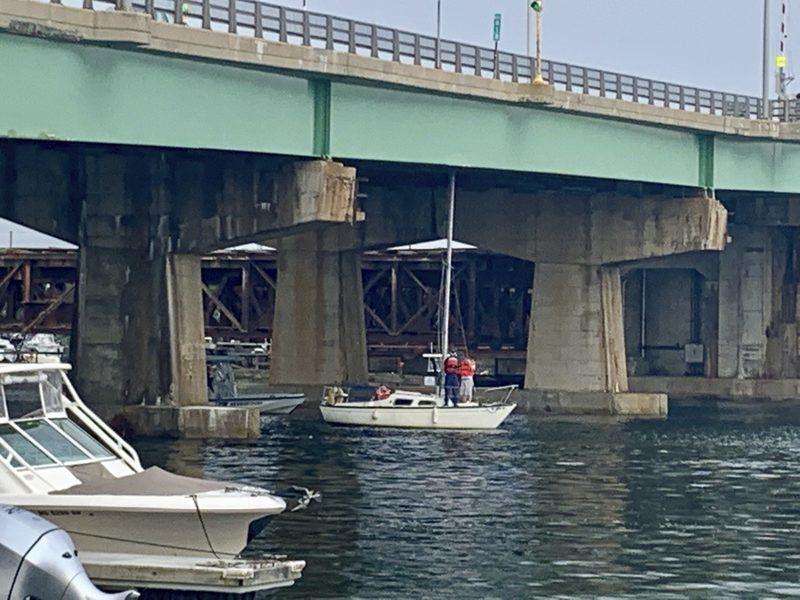 Sailboat freed after getting stuck under Gillis Bridge
