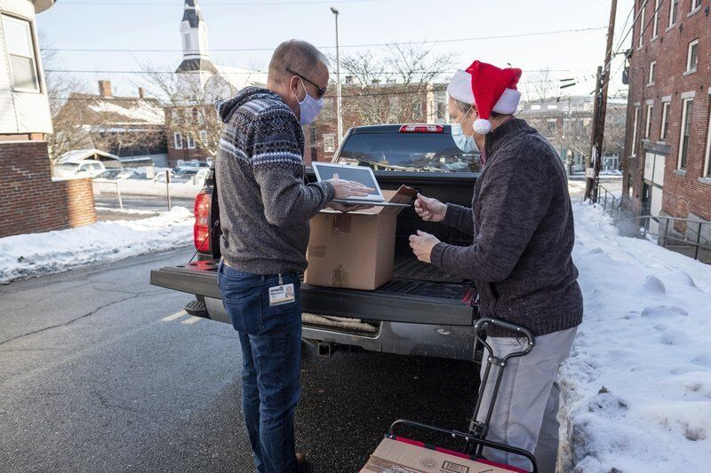 Amesbury father donates nearly 500 laptops to people in need
