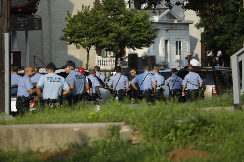 Gunman wounds at least 6 Philadelphia officers; 2 others freed
