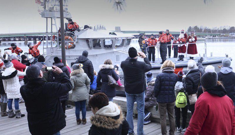 Holiday spirits high as Santa arrives by Coast Guard boat