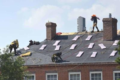 Heat wave or not, roofers toil on