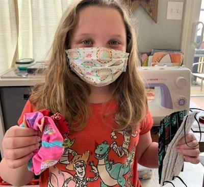 Merrimac girl, mother sew masks for those in need