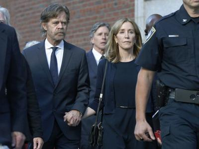 Huffman gets 14 days behind bars in college admissions scam