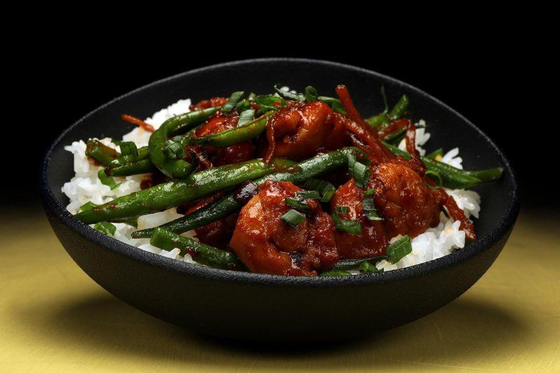 Spicy chile crisp -- so good you'll lick the spoon -- warms up chicken dishes