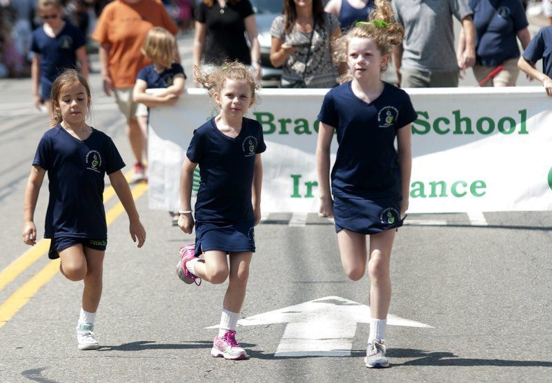 'A great family tradition' continues as 60th Homecoming parade steps lively