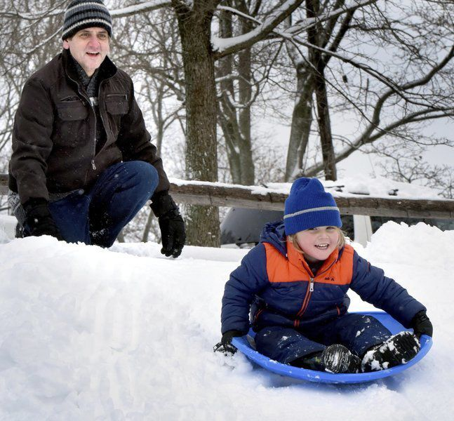 MARCH'S MADNESS: Kids flock to popular Port sledding hill