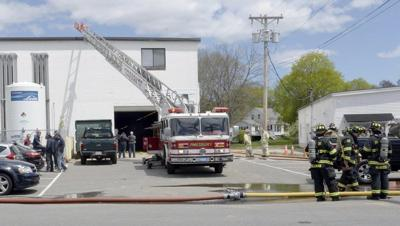 Fire threatens Amesbury industrial building