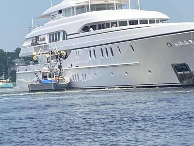 Yacht Bella Vita collides with moored fishing boat