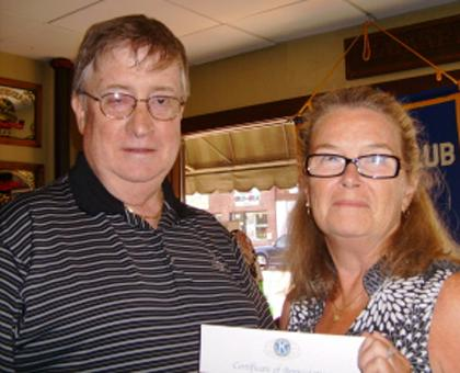 Kiwanis Club presents check for work in local schools