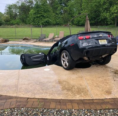 Impaired driver crashes Camaro into stranger's swimming pool, police say