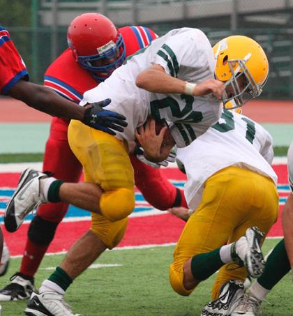 Knolls bows to East Orange in football