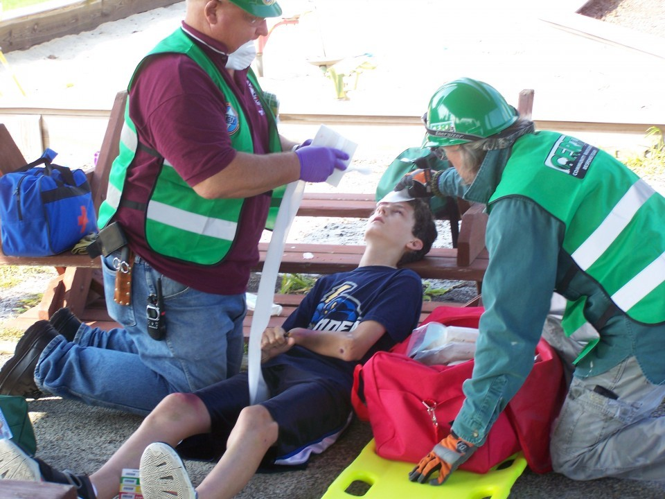 "Two unidentified CERT Team mebers tend to a ""victim"" during the Saturday morning disaster drill."