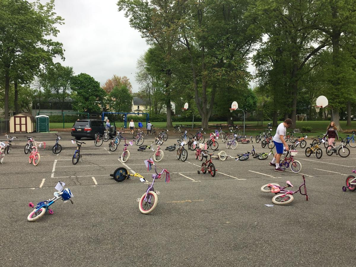 Gently used bikes lined up at Central Avenue School parking lot.