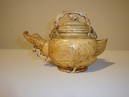 carved teapot