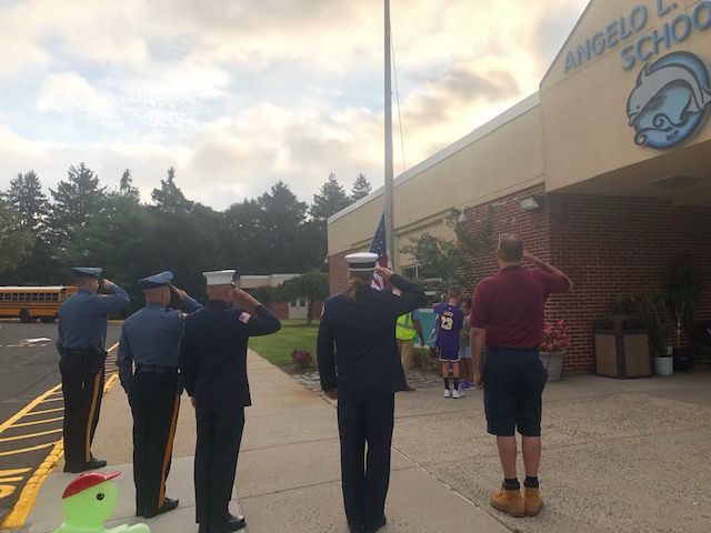 Flag salute at Angelo L. Tomaso on Patriot Day