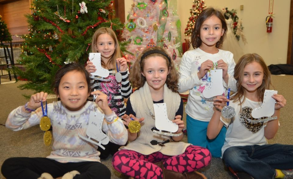 Girl Scouts Decorating a Tree