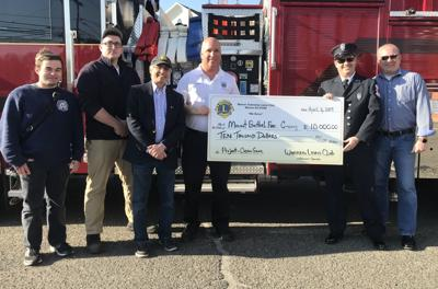 Warren Lions donate $10k for fire department facility