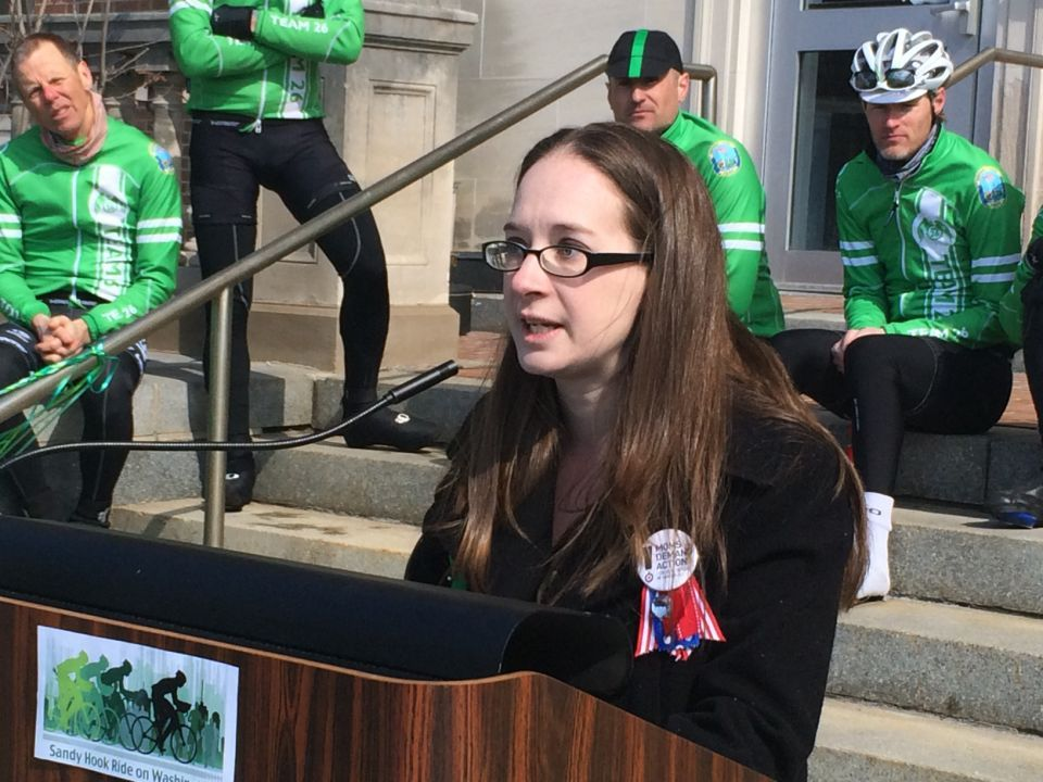 Maura Schwartz, flanked by members of Team 26 from Newtown, Conn., speaks to crowd