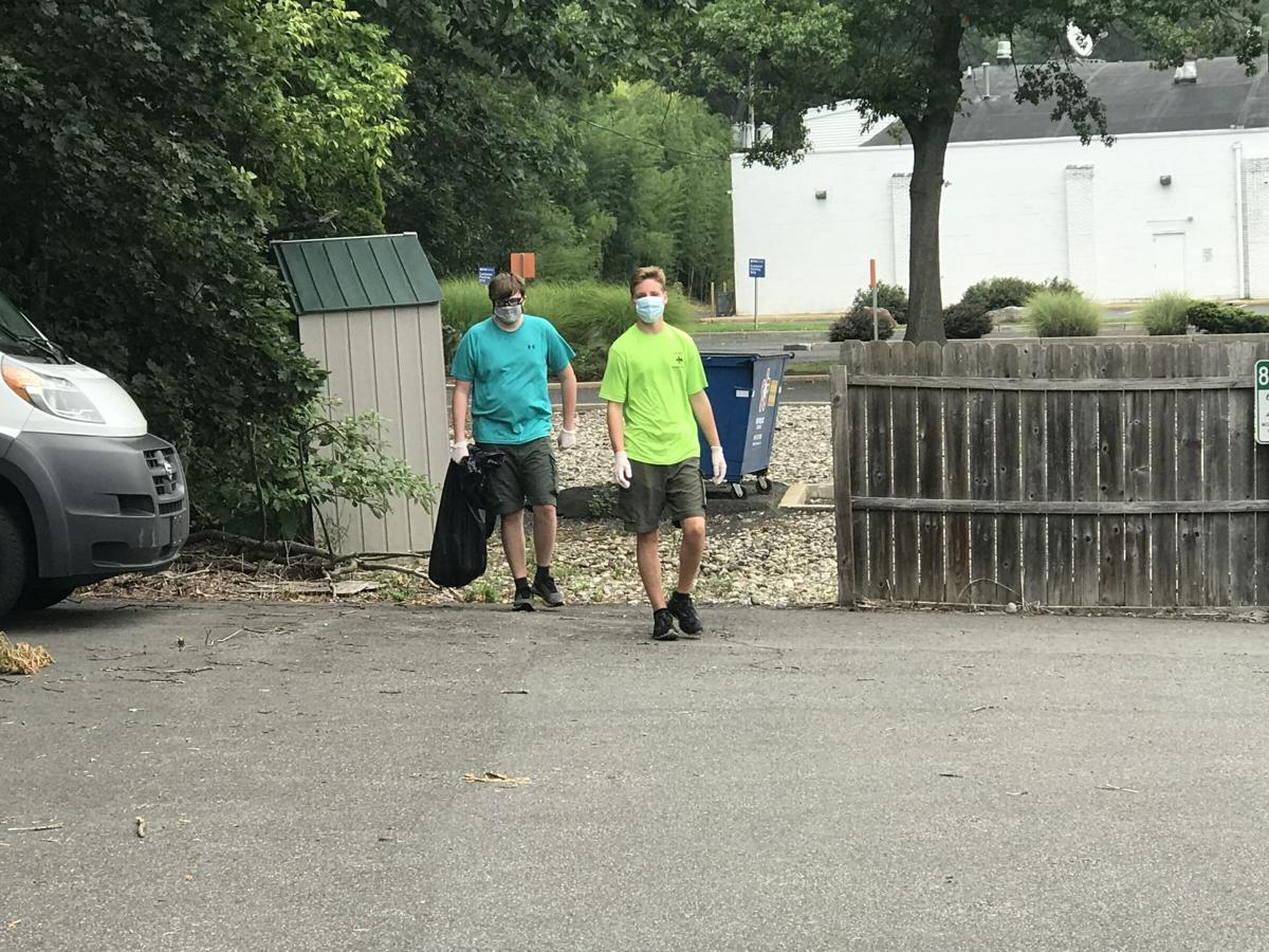 Boy Scout Troop 200 collects trash around downtown Clinton