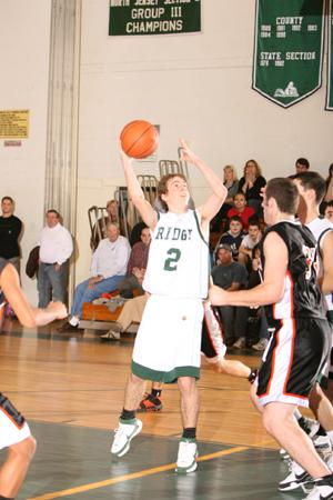 Ridge Boys Basketball—Devils clinch division, set sights on county