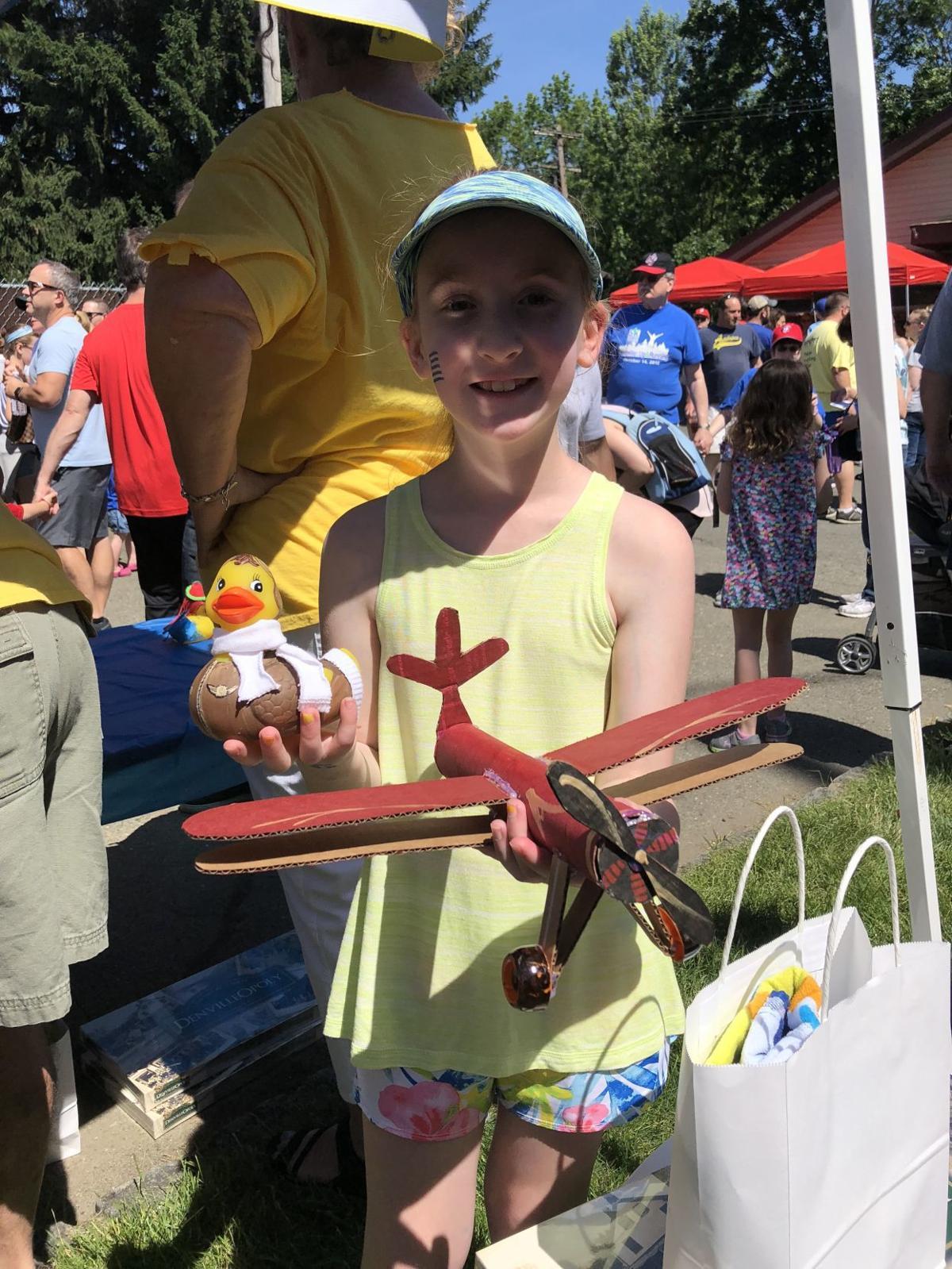(VIDEO) Hundreds of rubber ducks race in Denville's annual event