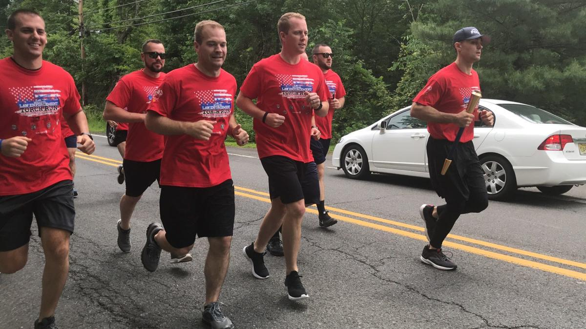 (VIDEOS) Long Hill police carry Flame of Hope for Special Olympics