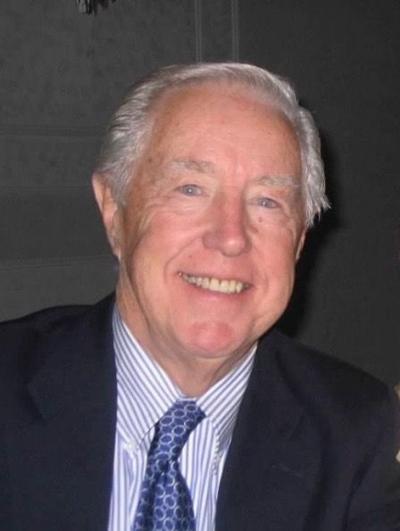 JAMES E. SPRY