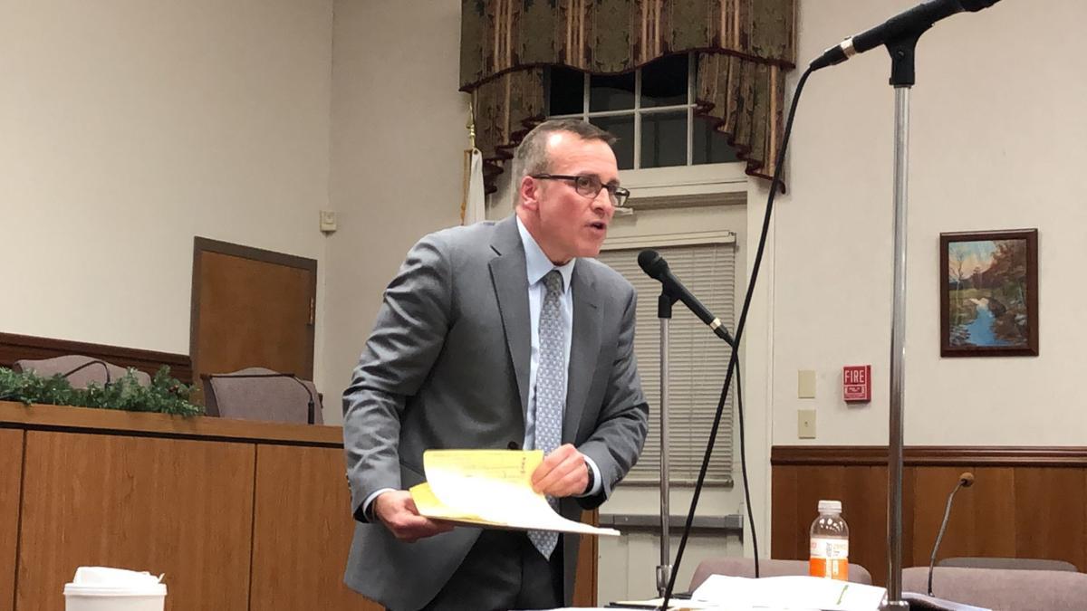 Steven Warner, zoning board attorney, addresses residents