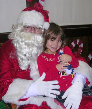 Tewksbury resident spreads holiday cheer by playing Santa