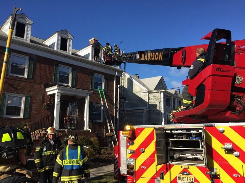 FIREFIGHTERS BATTLE COMMUNITY HOUSE FIRE