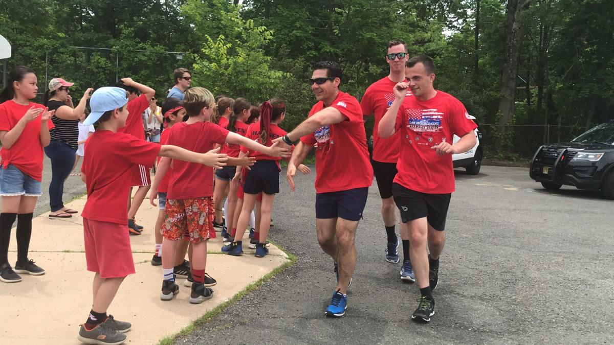 Long Hill police carry Flame of Hope for Special Olympics