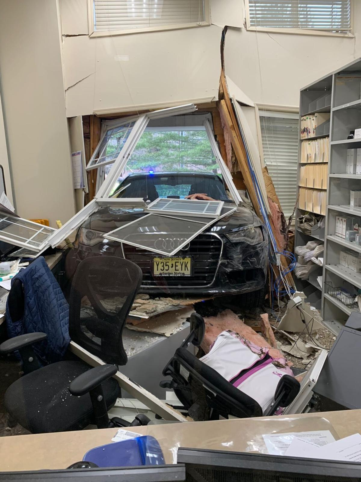 Woman hospitalized after car crashes into Warren dermatologist's office