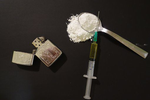 Jersey City pair charged with having 110 bags of heroin in Flemington