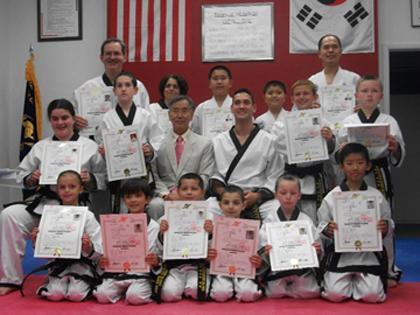 Complete Martial Arts students receive 1st degree Black Belts
