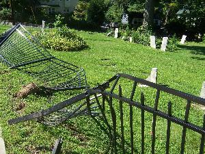 Car crash damages cemetery fence