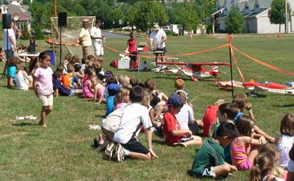 Warren Recreation program model airplane demo is a highlight of playground program's family day