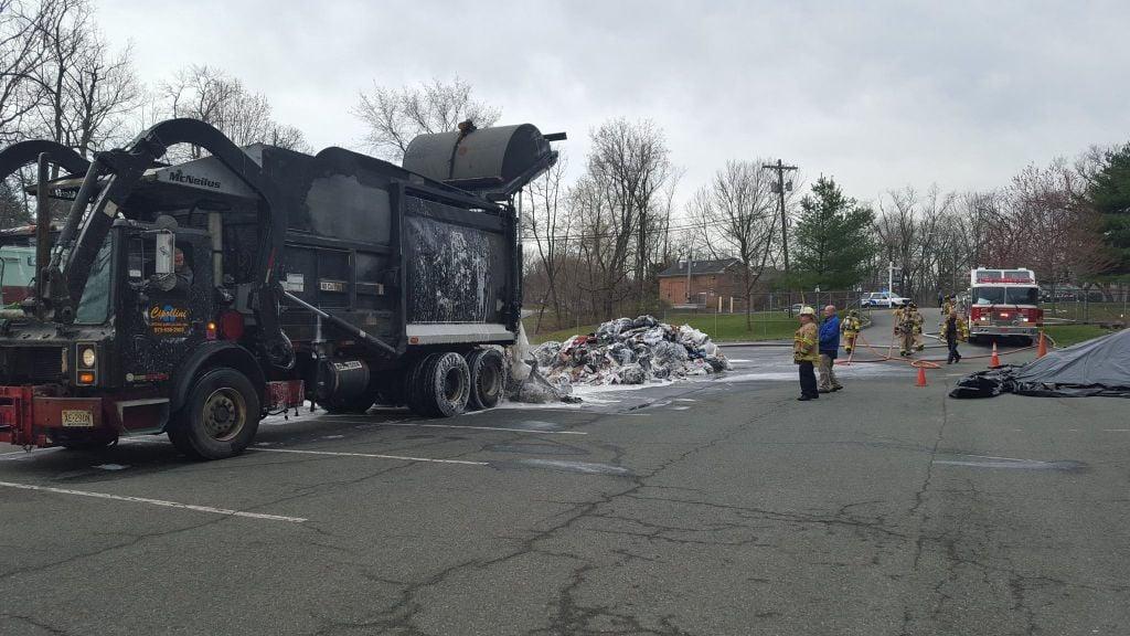GARBAGE TRUCK FIRE EXTINGUISHED