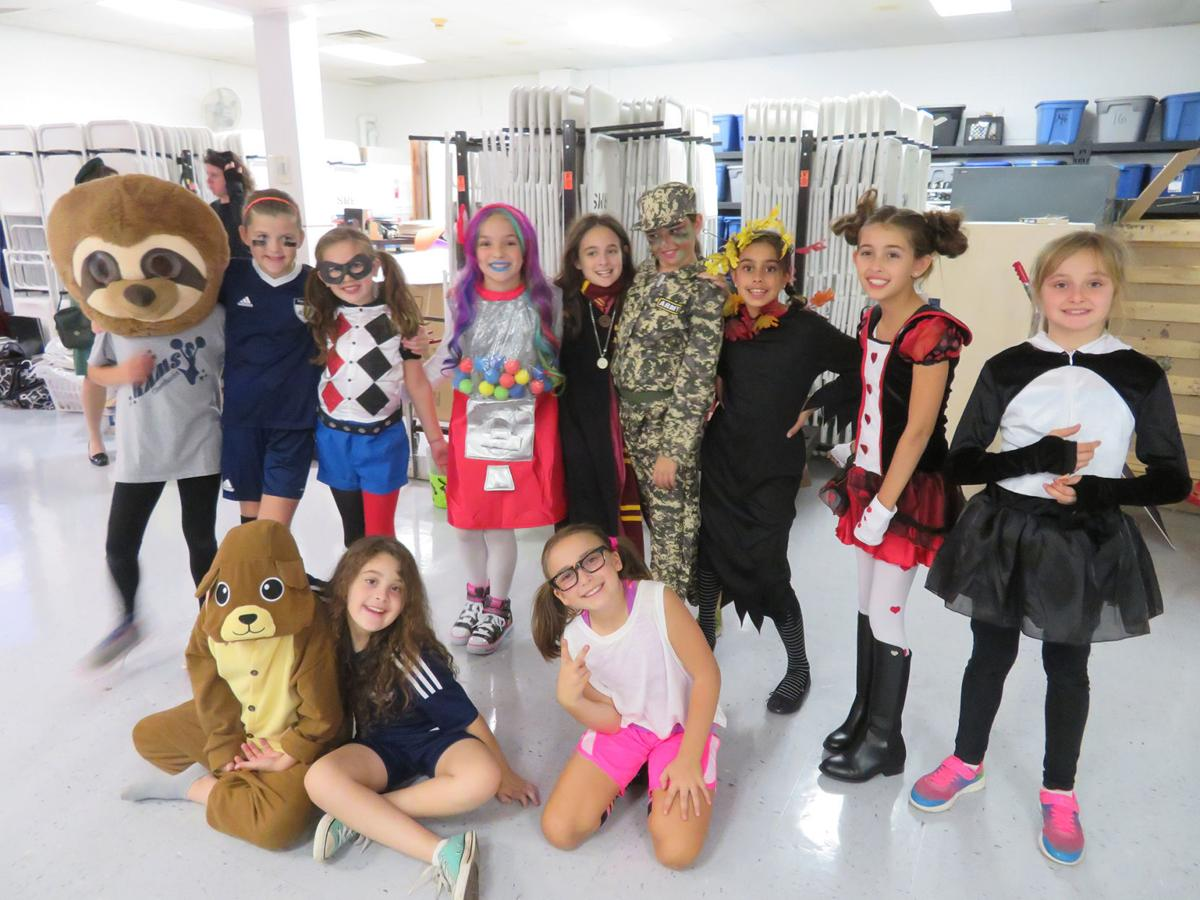 participating in girl scout troop 6176s halloween blast at randolph middle school on friday oct 20 are front row from left brooke baidwan