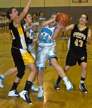 Unbeaten Morris Catholic girls defend MCT hoop crown