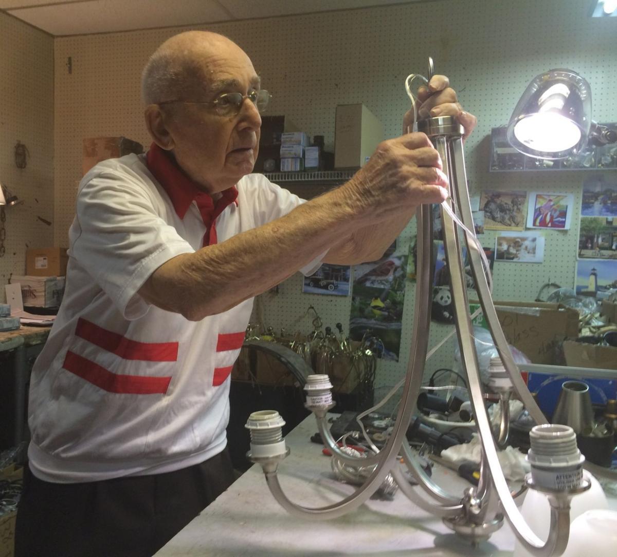 Hy Goldman at work at Capitol Lighting