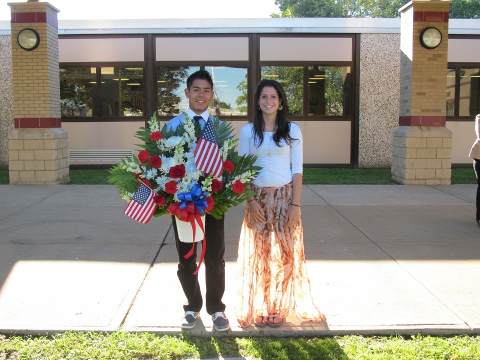 Student council members pay their respects at the memorial garden