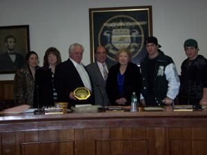 John DePola honored a year later;former councilman was often thorn in old council's side