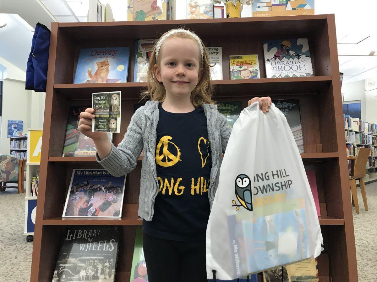 Long Hill Library offering drawstring bags to young library users